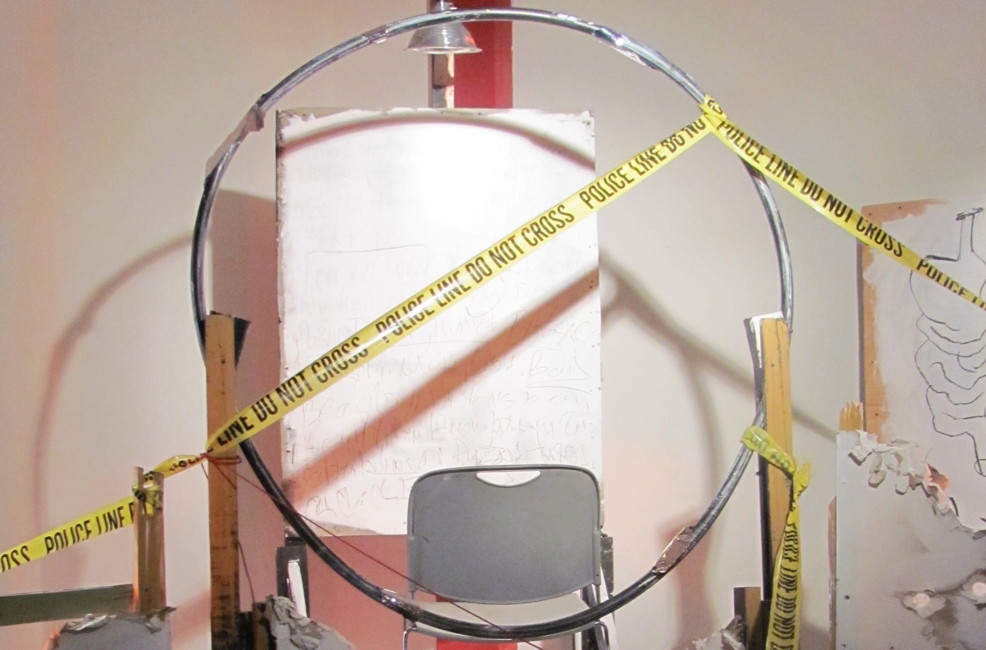 Image of a set with police tape crisscrossing the set